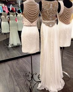 #SherriHill short and long dresses. White dress with beading and pearls. Form fitted, sexy white dresses. Short and long dress with illusion back and beads and pearls draping in the back.