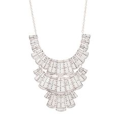 Embrace the bold, tribal look of the Maya necklace. This three-tiered piece features a dramatic bib of silver-plated, textured grain cut-outs. Maya is both a striking and neutral choice for a variety of statement occasions.$60