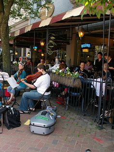 Ashville, North Carolina -  while near The Biltmore, eat as many times as you can at The Bistro downtown, and have the crabcake-bacon appetizer to start.  Catch an outdoor table to enjoy the always changing street entertainment & just people-watch this eclectic & artsy community.