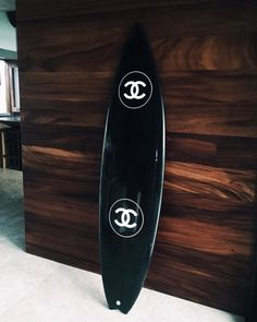 Why on earth is there a Chanel surf board. And why on earth must I have it.