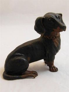 A fabulous cold painted Austrian bronze inkwell depicting a Dachshund dog seated, this charming item is rear hinged at the neck opening to reveal a compartment for a liner.