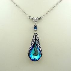 blue crystal. - would love these in earrings...