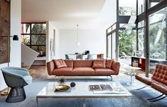If you are at home in a modern mid-century living room, a red-brown sofa can be optically cooled by using a gray rug and a gray accent chair. A duo of coffee tables with marble tops complete the look. Mid Century Modern Living Room, Mid Century Modern Design, Living Room Modern, Living Room Sofa, Living Room Interior, Living Room Designs, Living Room Furniture, Living Rooms, Sofa Design