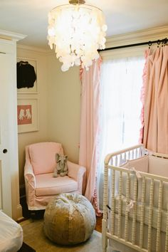 This #peaches and #cream #nursery has a majorly cool look with a #rustic mirror and brushstroke artwork.