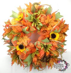 Custom ordered fall wreath with sunflowers, deco mesh and roping for a special customer. Contact us if you would like a custom fall wreath for your door at www.southerncharmwreaths.com
