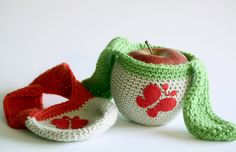Green and red crochet apple fruit cozies with felted butterfly.