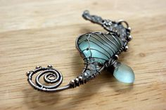 Beautifully wire wrapped sea glass seahorse pendant in sterling silver with gemstones. #jewelry