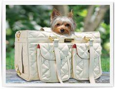 A little yorkie lounging in a Jaraden Mon Ami Pet Dog Carrier. #stylishdogs