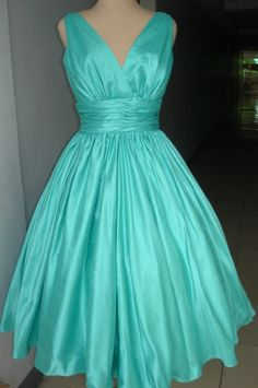 Our perfect and simple 50s cocktail dress in stunning glimmering turquoise. Specialising in made to measure. Any size welcome.. $245.00, via Etsy.