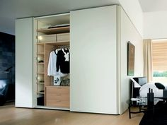 sectional wooden wardrobe with sliding doors Gliss 5th | wardrobe with sliding doors, design Molteni Design Team, Gliss collection to manufacturer Molteni & C.