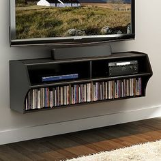 Just the picture - no details - so get ready to DIY it!  Entertainment shelf
