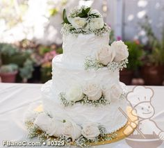 "Design W 0329   Butter Cream Wedding Cake   12""+9""+6""   Serves 100   Textured Butter Cream, Fresh Flowers   Standard Price"