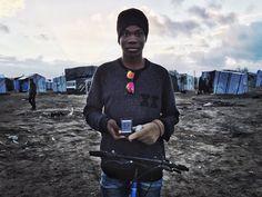 refugee migrant phone calais camp