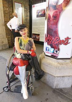Wheelchair disabled fashion street styler in front of the Broadway show Kinky Boots.