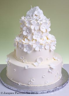 Ecru-colored cake with delicate white accent flowers