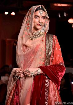 Deepika Padukone is the quintessential bride as she walks the ramp for Anju Modi. via Voompla.com