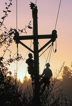Lineman climbing the power pole