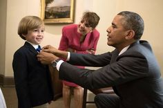 Looking sharp....President Obama helps this young man with his tie. The President is SO AWESOME!!!