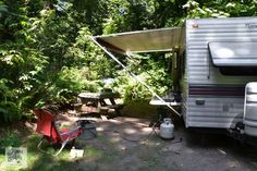Tips for camping in a travel trailer / setup, water, levelling, towing and more! via FunkyJunkInteriors.net