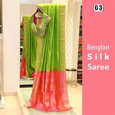 Bright weaves of silk... Parrot Green Silk Saree with Pink Pallu. . For price or detail do whatsApp +91-9913433322