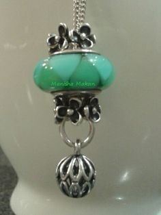 My beautiful teal necklace. Featuring Teal Murano and pendant. Created by me!