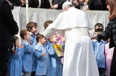 """Keep this in mind,"" the pope told parents, ""playing with your children, 'wasting time' with your children, is also a way to transmit the faith. It is graciousness, the graciousness of God."""