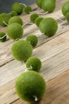 OMG Im dying of a craft attack! I want to buy yards and yards of this moss ball garland and hang it everywhere.