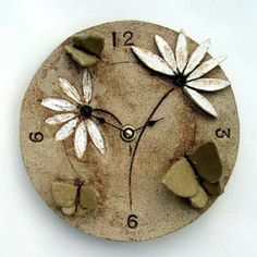 Ceramic wall clock with stylised butterfly and daisy motifs, with a rustic background finish. Ceramic Wall Art, Ceramic Clay, Ceramic Pottery, Cerámica Ideas, Diy Clock, Ceramic Animals, Cat Wall, Clay Design, Paperclay