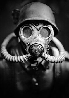 WWII German Soldier in A Gas Mask. Hitler should be given credit for seeing that gas was not used during the European war due to his own disgust with chemical warfare. He had been a gas casualty during the First World War. Gas Mask Art, Masks Art, Gas Masks, Black And White Face, Sucker Punch, War Photography, Photography Ideas, Artistic Photography, Vintage Photography