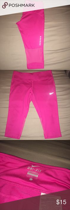 Pink Nike Dri Fit Capris Pink Nike Dri Fit Capris in great condition. Has mesh panels on the back calf area. Super cute! Nike Pants Capris