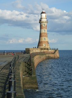 A majestic Roker Pier lighthouse at the mouth of the River Wear in Sunderland, England 54.921327, -1.352200