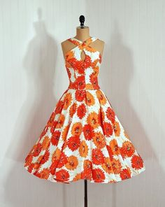 1950's...not usually an orange person but this just reminds me of late summer and my birthday, and would look great at an outdoor party.
