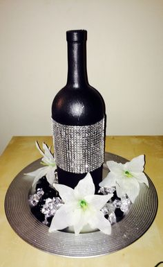 BLACK AND SILVER wine bottle centerpiece wrapped in silver rhinestone mesh ribbon