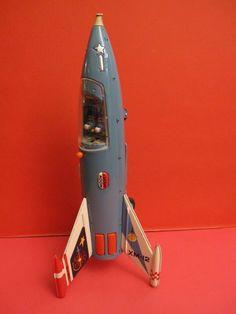 Time to Grab a New Toy Rocket Toy Rocket, Retro Rocket, Rocket Ships, Metal Toys, Tin Toys, Antique Toys, Vintage Toys, 1950s Toys, Space Toys