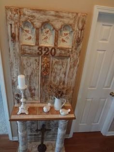 vintage door turned into hall tree for the entrance, home decor, repurposing upcycling, Wanted to highlight the three glass arched windows so decided to stencil birds on pieces of wood and we nailed the pieces behind the windows