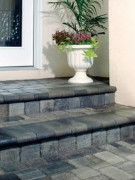 Cover Concrete Steps With Pavers - this is an inexpensive way to add curb appeal to your home. This site has a lot of examples of how paving stones have been used to update homes' exteriors. Via Willow Creek Paving Stones Concrete Porch, Concrete Steps, Porch Tile, Cement Patio, Concrete Pavers, Travertine Pavers, Pavers Patio, Stamped Concrete, Patio Steps