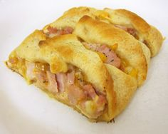 What to do with Left Over Ham...This was a Hit with My fam :)..Ham & Cheese Braid Very easy to make 1 can crescent rolls (or Recipe Creations)  1 1/3 cups chopped ham  2/3 cup cheddar cheese, grated  1/4 cup honey mustard Bake at 375 for 15-20 minute