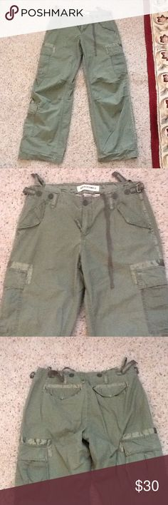 ABERCROBIE KHAKI GREEN CARGO ARMY PANTS w/RIBBONS NWOT Abercrombie sz 4 green cargo pants with ribbon accents.  Many pockets.  Really gorgeous pants!  Will ship right away.  Check out my other designer items Abercrombie & Fitch Pants Boot Cut & Flare