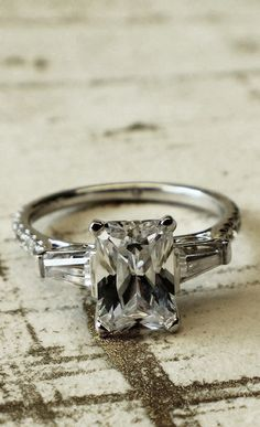 White Gold Contemporary 3 Stone Engagement Ring  - the stones on the sides beautiful!!