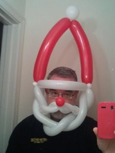 Santa Hat/Mask....never seen one with the mustache before...gotta remember that for next year.