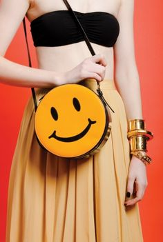 Vintage Moschino patent leather smiley face bag $395.