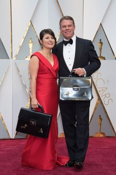 Pricewaterhouse Cooper representatives arrives on the Oscar® red carpet. #Oscars #Oscars2017 #redcarpet #4chionstyle #fashion #style