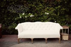 Vintage white couch from Found Vintage Rentals.