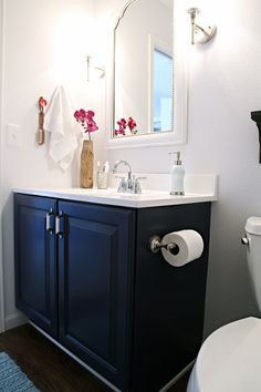 Navy blue cabinets. A blog about all the steps she did to paint cabinets/redo br.