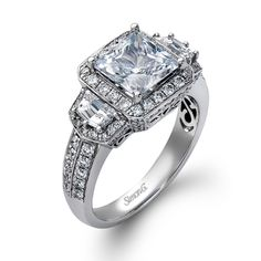 This is my dream ring - Might change flanking diamonds to canary though...  <3  Trio Collection � This gorgeous 18K white engagement ring is comprised of .71ctw round white Diamonds and .50ctw cadillac cut white Diamonds.  � MR1548