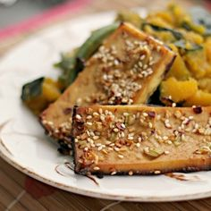 Asian sesame tofu with braised winter squash and green beans.