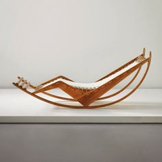 Image 9 of 14 from gallery of Sold! 100 Design Relics from Niemeyer, Le Corbusier, FLW and More. Franco Albini: Early and rare rocking chaise longue,circa Image Courtesy of Phillips