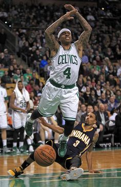 Pacers guard George Hill fouls Boston Celtics guard Isaiah Thomas in the third quarter of the NBA game at the TD Garden on Wednesday, April 01, 2015. Celtics top Pacers 100-87 | Boston Herald