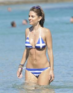 The 35-year-old, Maria Menounos who is of Greek descent, donned a patriotic string bikini emblazoned with the colours of the Greek flag for a relaxing dip in the South Aegean Sea.