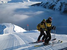 Before the runs open Ski Patrollers ensure pistes are safe